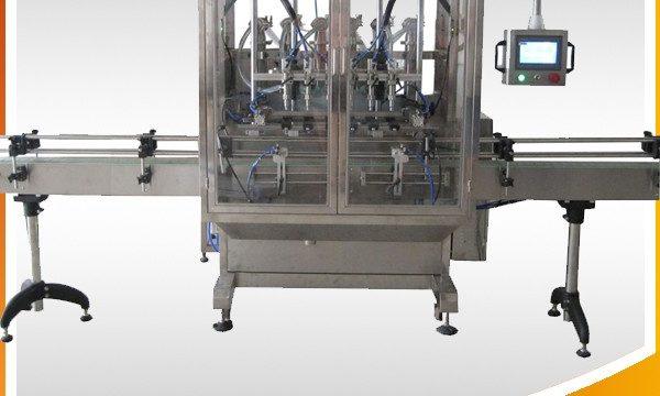 Riempitrice per liquidi a bottiglia con gravità a trabocco automatico